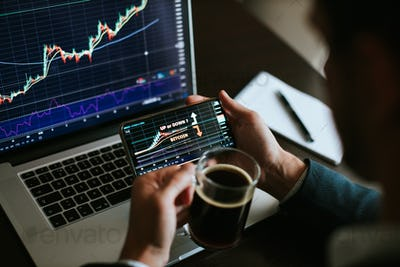 stockbroker analyzing bitcoin price uptrend or downtrend