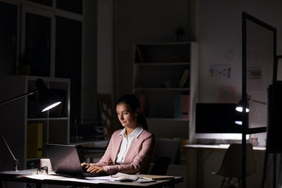 Woman working in dark office