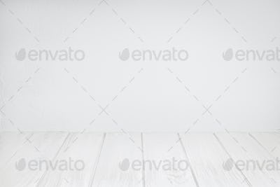 Empty Wood Table On white washed Textured wall
