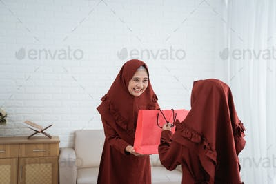 mother give gifts to their daughter