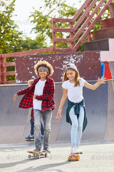 Children on skateboards outdoors