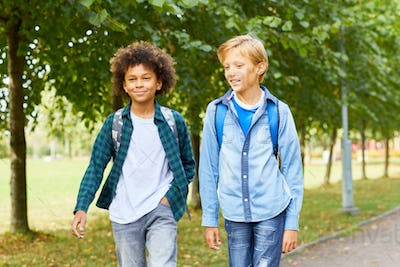 Two boys walking outdoors