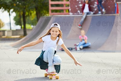 Girl on skateboard in the park