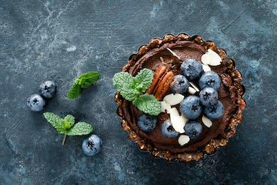 Healthy raw vegan dessert dates tartlets with chocolate cream