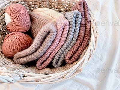 woolen knitted hats and balls of thread