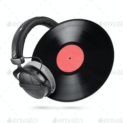Studio headphones and vinyl record isolated on white