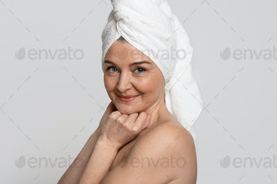 Portrait Of Attractive Nude Middle-Aged Woman With Towel On Head
