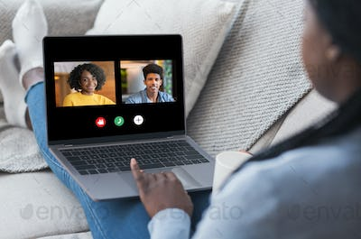 Black Woman Having Online Video Call On Laptop With Friends