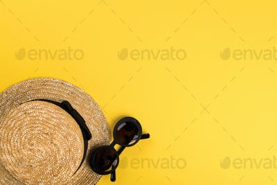 Straw Beach Woman's Hat Sun Glasses .Summer time vacation concept.Travel mood to the sea.