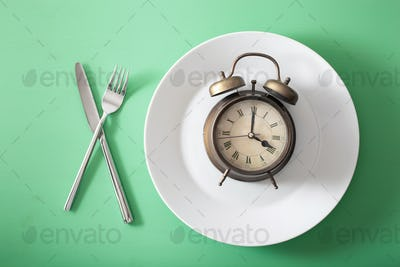concept of intermittent fasting, ketogenic diet, weight loss. fork and knife crossed