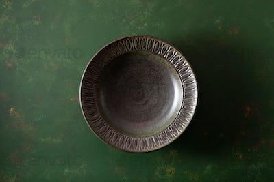 empty plate on dark green background