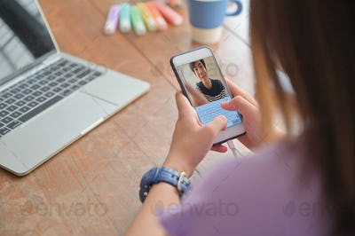 Young women video calling with lovers on a smartphone.