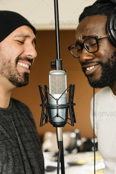 Multiracial artists singing on studio.