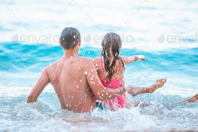 Father and his daughter enjoy beach vacation