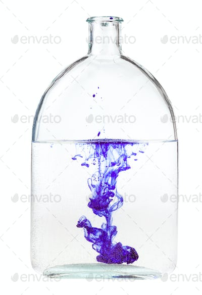 violet ink dissolves in water in bottle isolated
