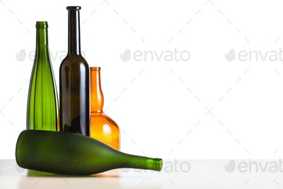 empty bottles on table with cutout background