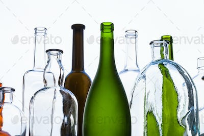 various empty bottles and view of gray sky