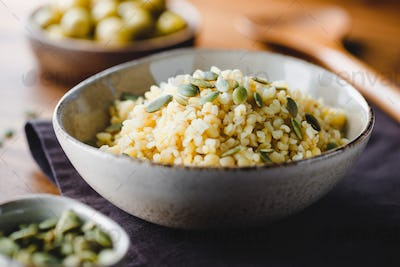 Bulgur with pepitas, healthy nutrition easy recipe from long-stored food.