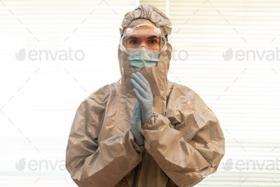 Female Doctor in PPE Personal Protective Equipment clap