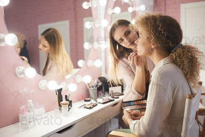 Professional Makeup Artist Working with Client
