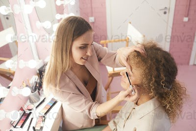 Female Make up Artist Working with Model