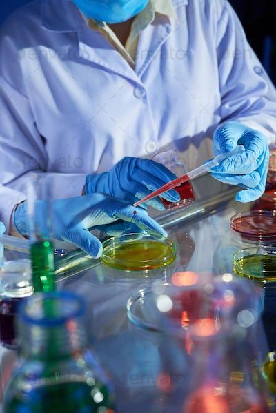 Laboratory technicians mixing reagents