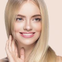 Blonde hair woman natural skin female beauty healthy teeth smile