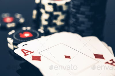 Deck Of Cards With Ace On Top And Stack Of Poker Chips.