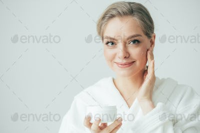 Woman face cream, happy young female cosmetic beauty, pure and fresh healthy skin