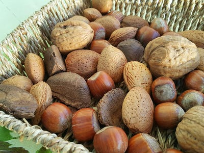 Various nuts in a wicker bowl