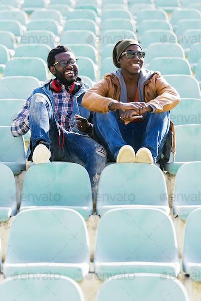 Two black race friends having fun in the park.