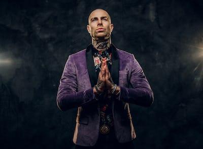 Elegant tattooed male model posing in a studio