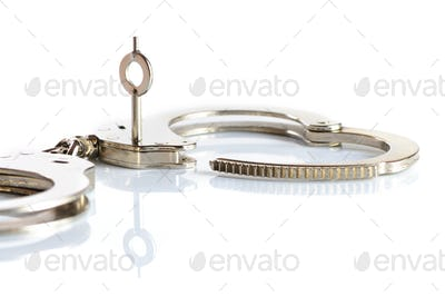 Close-up of a key opens a handcuff