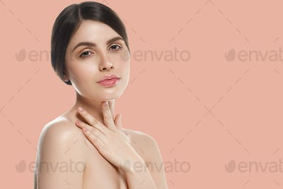 Beauty woman over pink background healthy skin