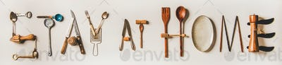 Stay at home lettering made from kitchen utensils, wide composition