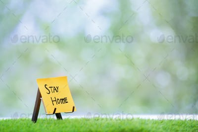 Adhesive note with Stay Home text