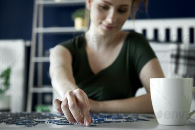 Woman spending time on doing some puzzle game