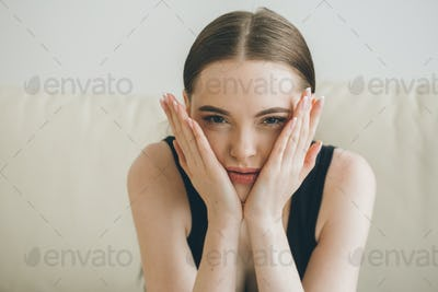 Stressed woman at home headache pain female portrait. Beautiful girl close face and head