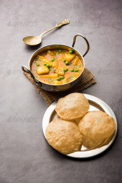 Indian style Potatoes curry with fried bread called puri