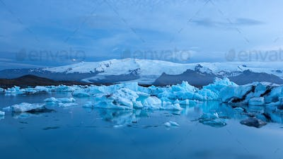 Jokulsarlon, glacier lagoon in Iceland at night with ice floating in water