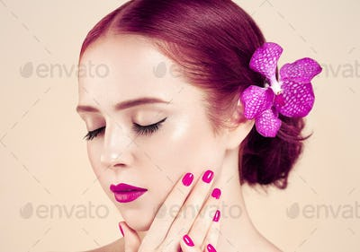 Beautiful woman portrait flower hair perfect make up manicure red lips nails  beige background