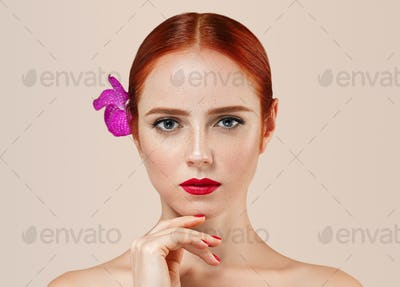 Beautiful woman portrait with perfect make up manicure red lips and nails