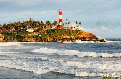 Lighthouse on the rocks near the ocean in Kovalam, Kerala, India