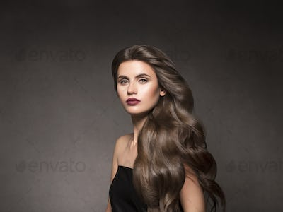 Beauty hair woman portrait long curly hairstyle female with fashion makeup and healthy skin