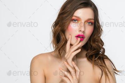 Colorful makeup woman face, beautiful brunette, beauty fashion girl model pink lips. Gray background