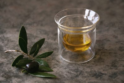 Olive oil in the glass and olive