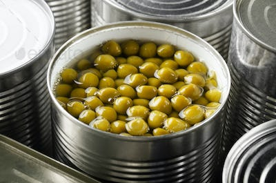 Canned green peas in just opened tin can. Non-perishable food