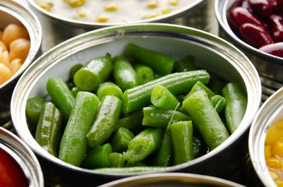 Canned green beans in just opened tin can. Non-perishable food