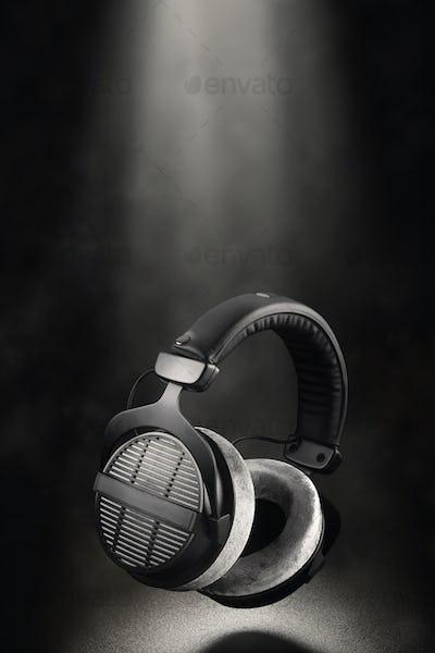 Professional studio headphones on black background.