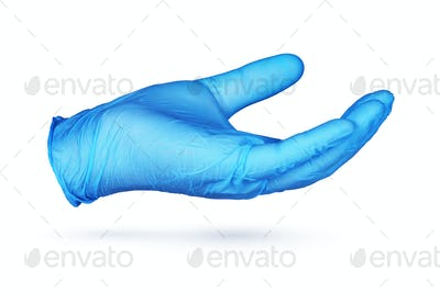 Hand in blue protective glove holding something isolated on white